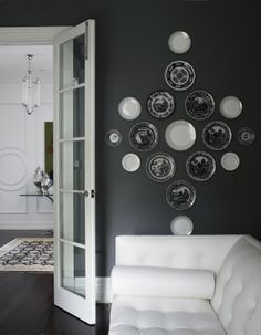 Greg Natale black and white plate collection. interior design, wall colors, vintage plates, black walls, decorating blogs, wall decorations, wall plates, plate wall, white furniture