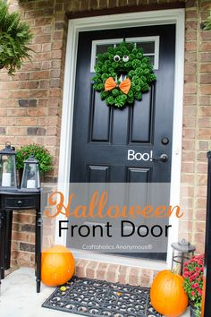 Cute Halloween door - Monster Wreath, Boo vinyl, pumpkins, and mums. So easy, so cute!