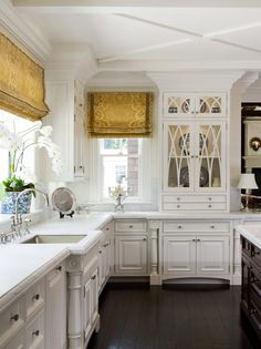 The details in this kitchen are amazing!  The mouldings, the countertops, the cabinetry - a lot of time went into this kitchen.
