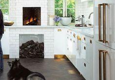 brass kickplates, drawer & refrigerator pulls, and white subway tile.