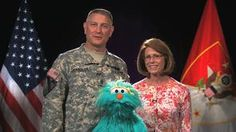Sgt. Maj. of the Army Raymond Chandler and Mrs. Jeanee Chandler send a happy birthday greeting to the U.S. Army with the help of Rosita from Sesame Street.