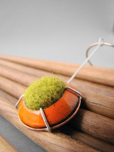 Enameled copper, wool and sterling