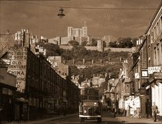 World War II view of Dover Castle from Castle Street, Kent, England, UK. King Henry II's Keep (Great Tower) is surrounded by the Inner Curtain Wall with Palace Gate on right. Below is Western Outer Curtain Wall with Queen Mary's Tower (left), Peverell's Gateway, then Gatton's Tower (right). Listed Building, English Heritage site, and Scheduled Ancient Monument. Second World War (1940): Urban, Norman Medieval History, Travel, Tourism, and Vacation. See: http://www.panoramio.com/photo/85930220