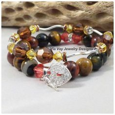 This unique handmade collection bracelet features 10mm Tiger Eye Beads, 14mm w/key 5x14 Sterling Silver Heart Charm with CZ, 6mm Padparadsch Swarovski...