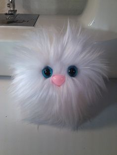 Furry Monster Plush - 4 White Coodle. $10.00, via Etsy.