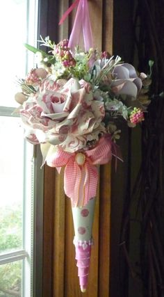 Pink paper roses in a cone