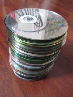 CDs and DVDs can be recycled at Best Buy. If you're worried about the data on them, just scratch them up! Read the adventures of An Exacting Life and how they found this easy waste solution.