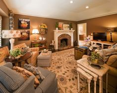 Warm & Cozy family room. I like the wall color.