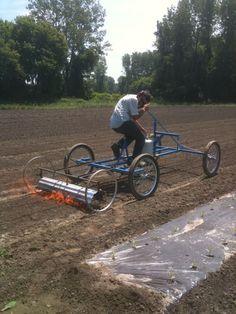 Pedal powered weed burner.