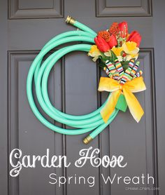 Made one of these for Ashley's teacher to thank her for a great year in first grade! Turned out so cute! hose wreath, idea, craft, front door, garden hose, gardens, spring wreaths, housewarming gifts, summer wreath