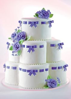 Scalloped Shaped Tiered Cake with Purple Ribbons shape tier, blue, purpl ribbon, tiered cakes, ribbons, wedding cakes, tier cake, purple roses, mini cakes