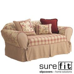 @Overstock - Sure Fit Lexington Washable Sofa Slipcover - Breathe new life into any sofa in your home with this high quality Sure Fit sofa slipcover. This slipcover features a floral pattern and two different plaid prints. Ruby red cord detailing also decoratively adorns this 100-percent cotton slipcover.    http://www.overstock.com/Home-Garden/Sure-Fit-Lexington-Washable-Sofa-Slipcover/2278531/product.html?CID=214117  GBP              58.41