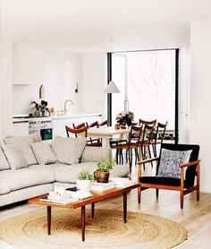 Midcentury modern furniture in a bright, open-plan living room.