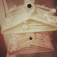 Every girls needs hangers like these hanging in her closet (; Some day ill glue gun them all like this (: