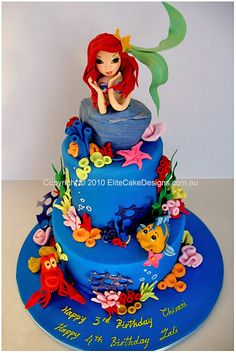 Amazing Little Mermaid cake-my momma made me an awesome little mermaid cake for my 4th birthday that no one at the party ended up eating! she was so  let down...the cake had a sand castle, a moat with swedish fish, ariel characters; the real deal. I love my family <3 -K