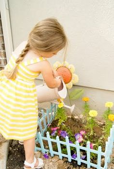 Kid's garden plot: Dollar store garden fence spray painted a color the kids choose - add a sign with their names