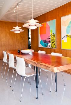 Love the natural wood table and art prints