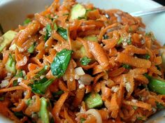 ASIAN CARROT SALAD ~         FOR THE SALAD:  4 cups grated carrots  1/2 cup cilantro, chopped  1/2 cup parsley, chopped  1 green onion, sliced (white and 1 inch of green parts)  1/2 cup raw sesame seeds, with 2 Tbsp set aside  1 medium avocado, chopped.    FOR THE DRESSING:  2 Tbsp flax seed oil  3 Tbsp lime juice  1 1/2 Tbsp Nama Shoyu (or soy sauce)  1 Tbsp fresh ginger, minced  1 Tbsp ground coriander  1 Tbsp agave nectar