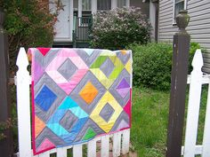 Rainbow Diamonds Mini Quilt Tutorial - cute!  made with half-square triangles.  finished size 36.5 x 40