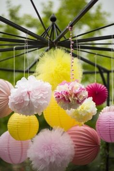 Sweet Details: A canopy of pink-and-yellow poms added some texture and color to the party. Source: Parties on a Pedestal
