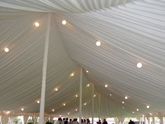 Pole Tent with liner, globe lighting and wrapped center poles from Taylor Rental of Manchester CT