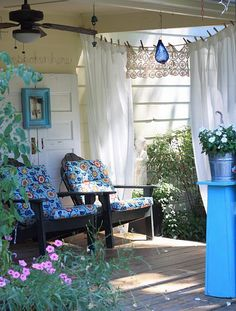 Cute way to hang outdoor curtains - clothesline and clothes pins