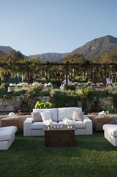 How exquisite is this outdoor lounge, set against a backdrop of grand mountains and a stunning dining area.