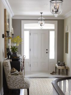 Sarah Richardson's Suburban House: New Home, Classic Style : a stylish subdivision home is created adding a few designer upgrades to the builder's standard options. Sarah makes a statement in the entryway using a few high-end cipollino marble tiles alongside standard hardwood flooring. --  HGTV