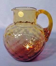 Amberina Diamond Quilted Water Pitcher: with applied and reeded amber glass handle Circa 19th century