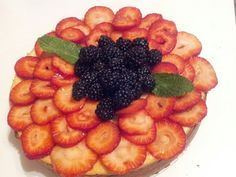 NY Style Cheese cake topped with fresh strawberries and Blackberries