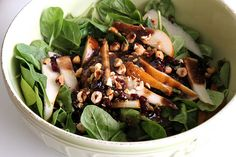 spinach salad with pears, cranberries, red onion and toasted hazelnuts