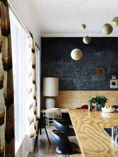 So much to love in this 1960s science-lab-inspired kitchen, from the globe mobile to the chalkboard wall.