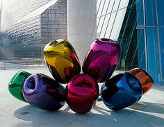Tulips by Jeff Koons. 199502004, Guggenheim Bilbao Museo: A bouquet of multicolor balloon flowers (made of high chromium stainless steel with transparent color coating) blown up to gargantuan proportions (more than 2 meters tall and 5 meters across)... #Installation #Sculpture #Balloons #Jeff_Koons
