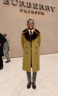 British musician Tinie Tempah wearing Burberry outerwear as he arrives for the Prorsum Menswear A/W14 show in London