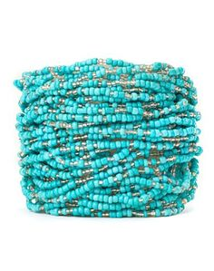 Hundreds of tiny *Turquoise and shiny silver seed beads strung together