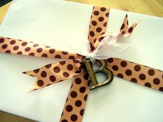 Simple ribbon tied onto a plain white box with a Hobby Lobby letter magnet makes for a very pretty package! via Older And Wisor