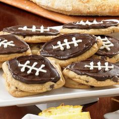 Chocolate Chip Football Cookies Chocolate chip cookie dough, chocolate and vanilla frosting.  Easy!
