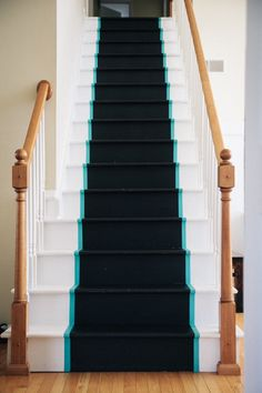 """I love this. She says, """"i painted a runner down the steps with off-the-shelf chalkboard paint. it has great grip for little feet. i also added thin turquoise stripes down each side. because everywhere needs some blue."""""""