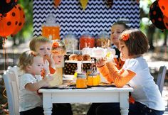 Kids Halloween Party Decor - we love the black and white chevron dessert table backdrop!