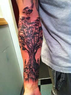 under the tree #tattoo.... i love this, you might just see this on my back one day.