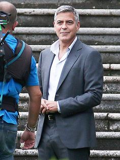 After wishing newlyweds Brad Pitt and Angelina Jolie well, George Clooney goes super-suave while filming an ad for Nespresso in Cernobbio, Italy, on Thursday.