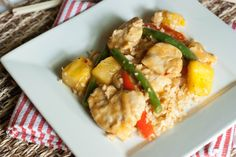 Pineapple Chicken Stir-Fry Over Cauliflower Rice (i'd use regular or brown rice)
