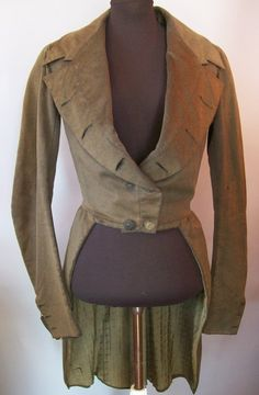 Fantastic olive green boiled wool jacket with printed silk lining. Circa 1820.
