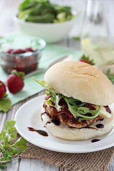 Recipe for turkey burgers with brie and roasted strawberries. Moist turkey patties topped with brie, roasted strawberries, arugula and balsamic glaze.