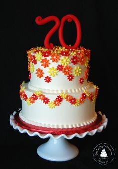 Birthday Cake Photos - Daisy themed 70th birthday cake, buttercream iced with fondant flowers and topper.