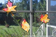 OMG, I love these! Stained Glass Autumn Leaves are the perfect way to decorate for fall. Plus, there's even a free printable template to make them even easier! | AllFreeKidsCrafts.com