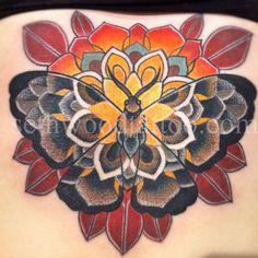 moth tattoo done by seth wood