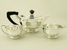 A fine antique George V English sterling silver three piece tea service/set in the Art Deco style; an addition to our silver teaware collection. SKU: W8813 Price GBP £1,295.00 http://www.acsilver.co.uk/shop/pc/Sterling-Silver-Three-Piece-Tea-Service-Art-Deco-Style-Antique-George-V-50p3074.htm#.U4SWlSjLJM8