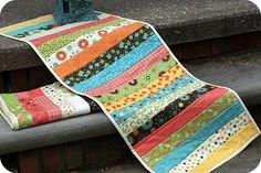 table runner. Do in holiday colors and prints. Fall colors for Autumn, Christmas colors for Christmas, Spring colors for Spring and Summer colors for Summer for sofa table. Wouldn't need much fabric of each color! Cute idea