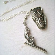 I love this necklace. The gun fits in the holster too.